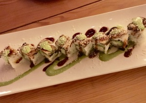 Eel roll with basil drizzle