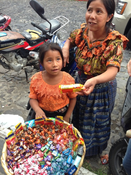 A little girl selling candy on the streets of Antigua, Guatemala