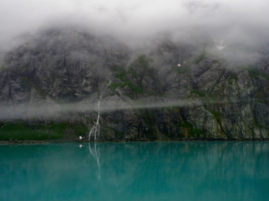 Waterfalls coming from the snow topped mountains in Glacier Bay, Alaska