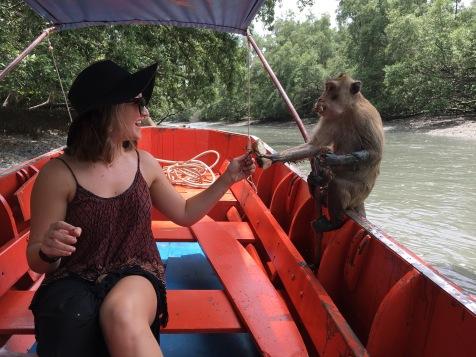 Feeding monkeys outside of Bangkok, Thailand