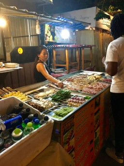 Grilled meat vendor at the night market in Chiang Mai, Thailand