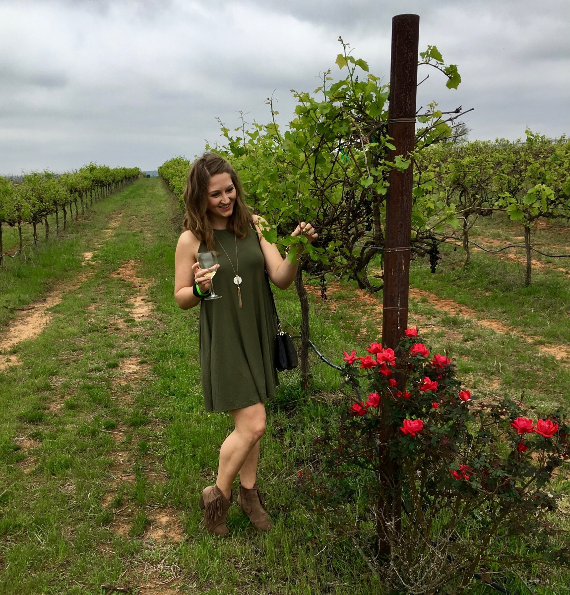 Playing in the vines at the Torre Di Pietra Winery in Fredericksburg, Texas