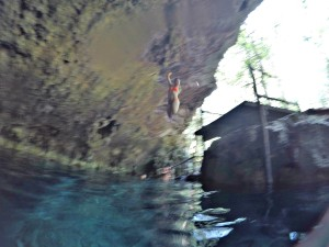 Jumping into the waters of a cenote in Tulum, Mexico