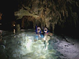 Exploring the waters of a cenote in Tulum, Mexico