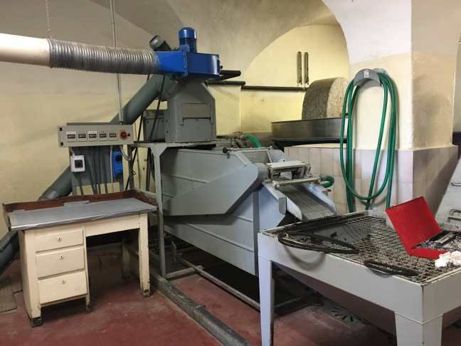 The olive press at Villa Li Corti in Italy