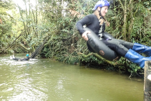 Practicing cave jumping for the Black Labyrinth Tour in Waitomo, New Zealand