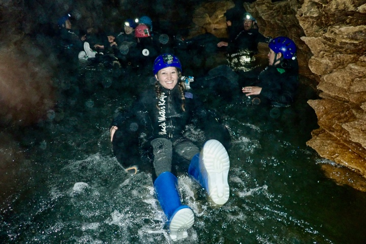 Cave jumping for the Black Labyrinth Tour in Waitomo, New Zealand
